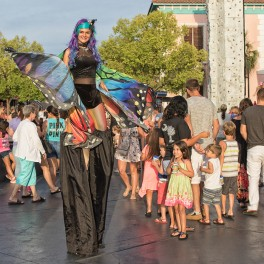 Guests Enjoying Butterfly Stiltwalkers at Broadway at the Beach